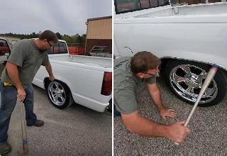 Redneck repairs car with baseball bat