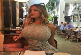 a very busty woman in tight shirt