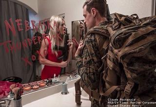 Photographer Devin Mitchell,using Photoshop, has created images of uniformed servicemen and women whose mirrored reflections reveal who they are  and vice versae.