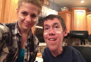Shane Burcaw is a 22 year old with Spinal Muscular Atrophy. Contrary to popular public belief, that's not his family member or his nurse . It's his girlfriend, Anna.
