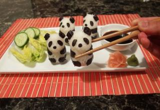 I don't know why this was in one of my albums, but I'm deleting it so I'll post it in case someone, somewhere, has some sort of love for sushi art. It is actually a bit impressive that someone can do this with food.