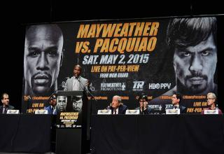 Mayweather vs Pacquiao press conference picture captured from live stream video. More info at my blog http://www.mayweathervspacquiaolivenews.com/