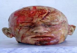 """Unbelievably realistic looking sculptures of dismembered human body parts sculpted entirely from bread."""""""