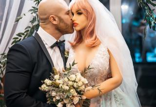 """Yurii Tolochko, a bodybuilder from Kazaksthan had proposed to his sex doll in December 2019, and finally tied the knots this year. Speaking about his wedding, Yurii wrote on Instagram: """"You often ask me about Margo. Margo is fine. I rarely show her, so as not to jinx it"""