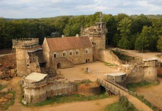 If you count using medieval techniques to build a castle, then yes. France is building a medieval castle in the 21 century.
