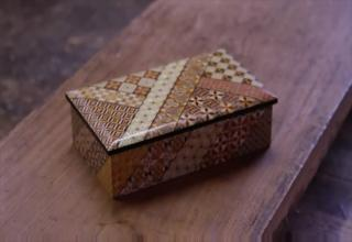 Woodworker, Noboru Honma, demonstrates the traditional Hakone wood mosaic, which is a type of parquetry popular during the Edo period 1603-1868 in Japan. By using razor-thin slices of wood, he's able to decorate a keepsakes box with elaborate patterns.