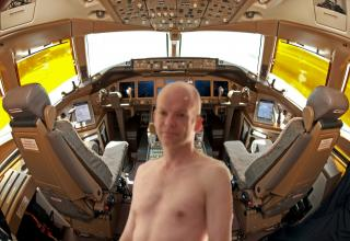 Captain Colin Glover, 51, was removed from flying duties after sordid images from the cockpit of a 777 were exposed.