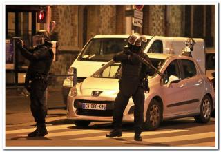 French police secure the area as shots are exchanged in Saint-Denis, France, near Paris, November 18, 2015 during an operation to catch fugitives from Friday night's deadly attacks in the French capital.Woman blew herself up,Terrorist shot by sniper,civilian dead,Policeman shot.Abdelhamid Abaaoud is presumed dead!