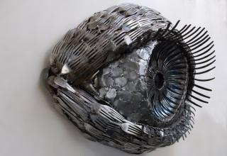 These beautiful animal sculptures were created with forks,knives,and spoons by Ohio-based artist Gary Hovey. He cuts and welds them into amazingly realistic animal sculptures..