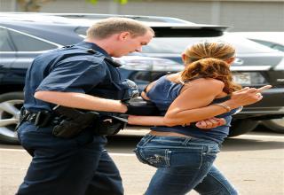 girls arrested shows middle finger