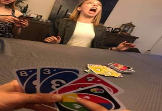 girl winning in uno making a funny face