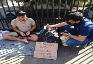 man begging for money so he can travel