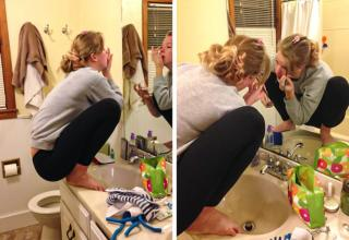 woman putting on make up sitting on counter