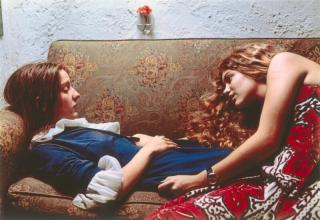 Two young girls on a couch taken in the 1970s.