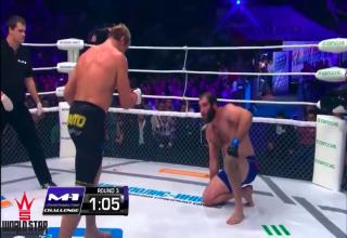 an mma fighter on his knees in front of his opponent